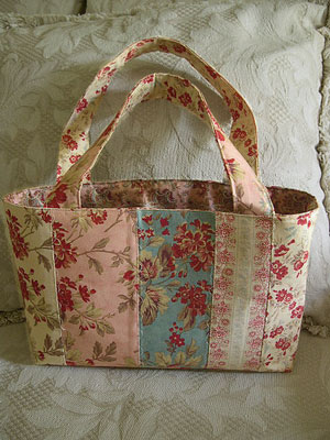 Enable Images to see a wonderful Patchwork Bag made with 3 Sisters fabric!