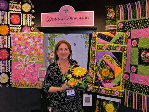 Enable Images to see Donna Dewberry's Quilt Market booth
