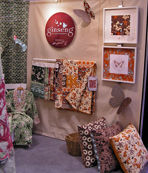 Enable Images to see Joel Dewberry's Ginseng Quilt Market booth