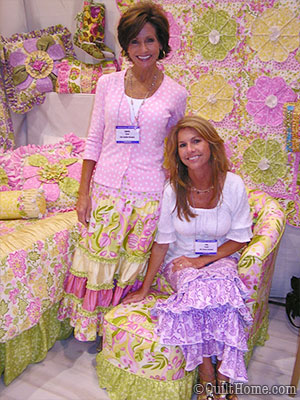 Lila (seated), and sister Laura, in her booth