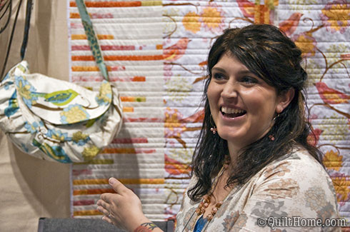 Valori Wells in her booth at Spring Quilt Market 2010